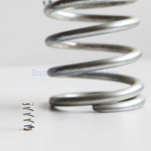 compare a big compression spring with a small one