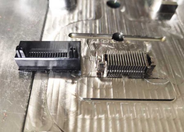 close view of mold for plastic pin connector