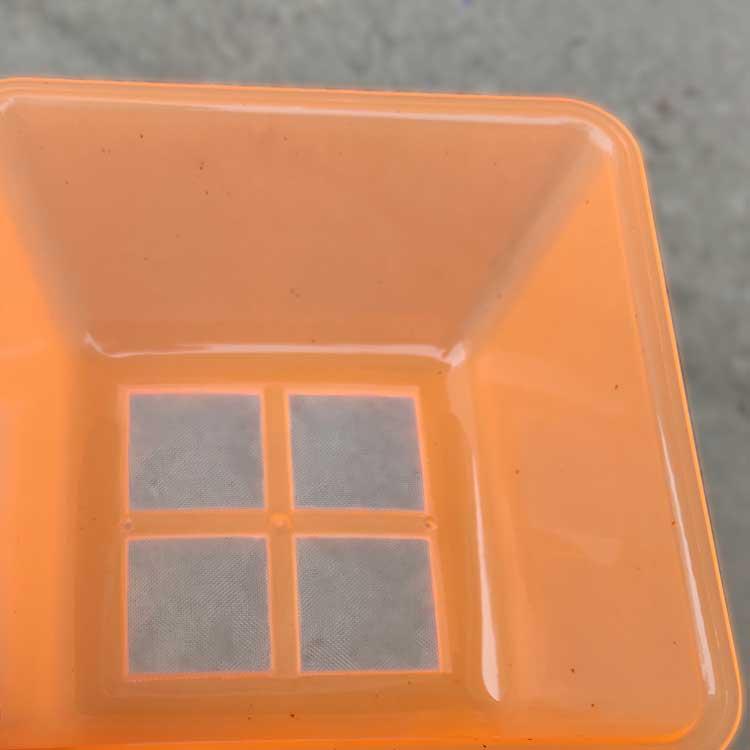 nylon mesh insert molded to plastic box